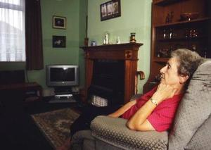Elderly woman sitting in an armchair