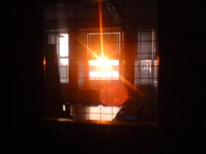 rising_sun_through_two_windows